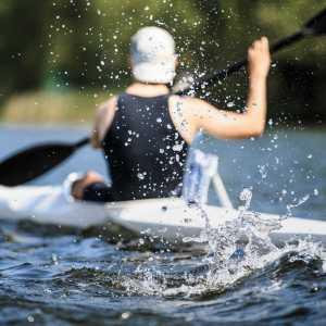 Athlete Rowing Kayak